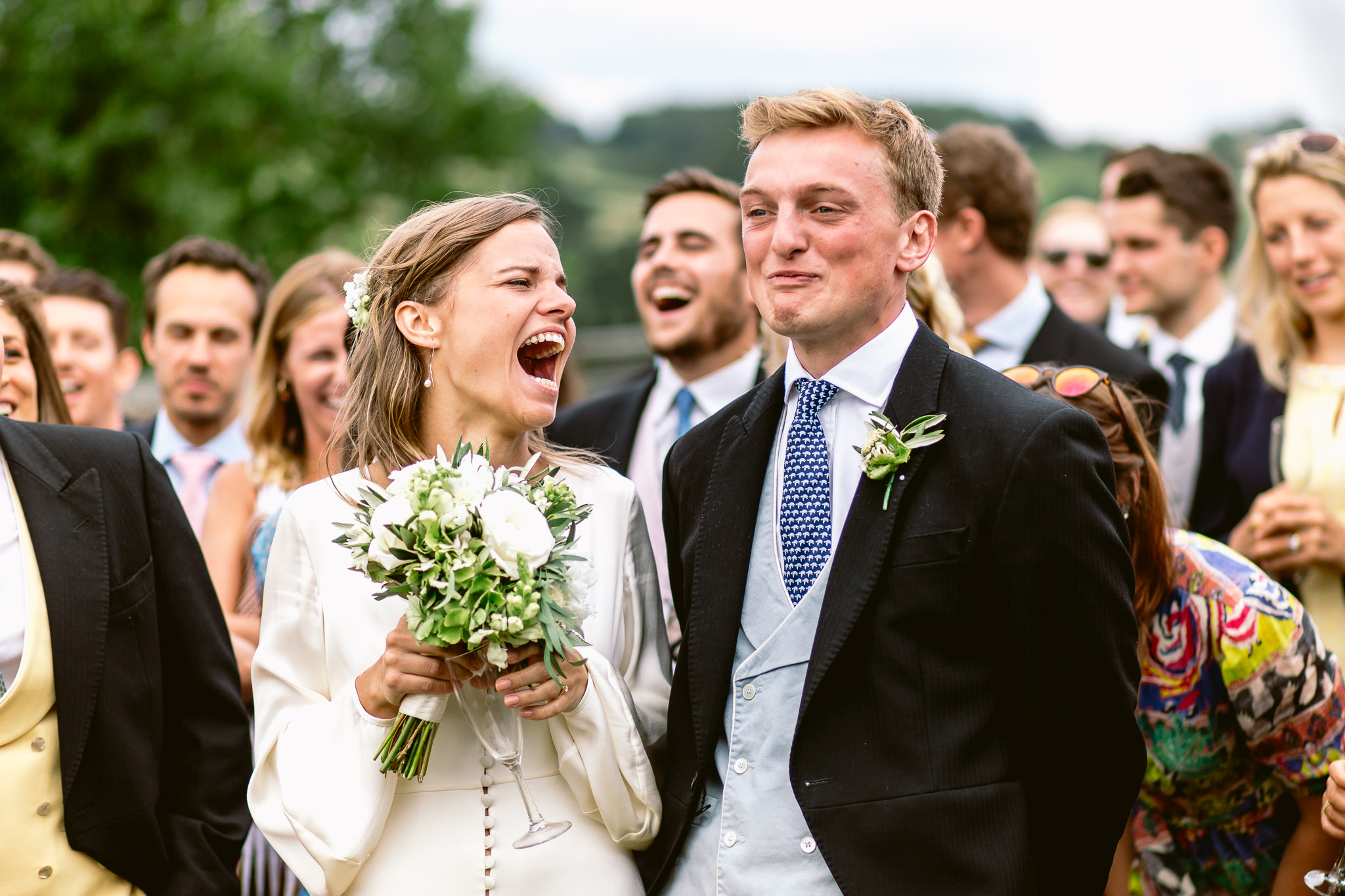 bride and groom laughing during the speeches best of 2017
