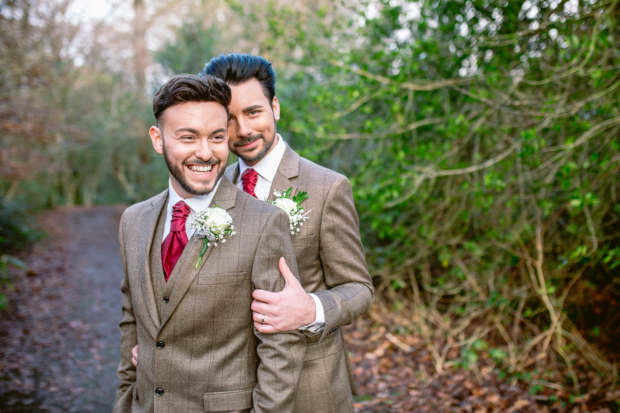 gay couple two grooms standing and holding each other best of 2017