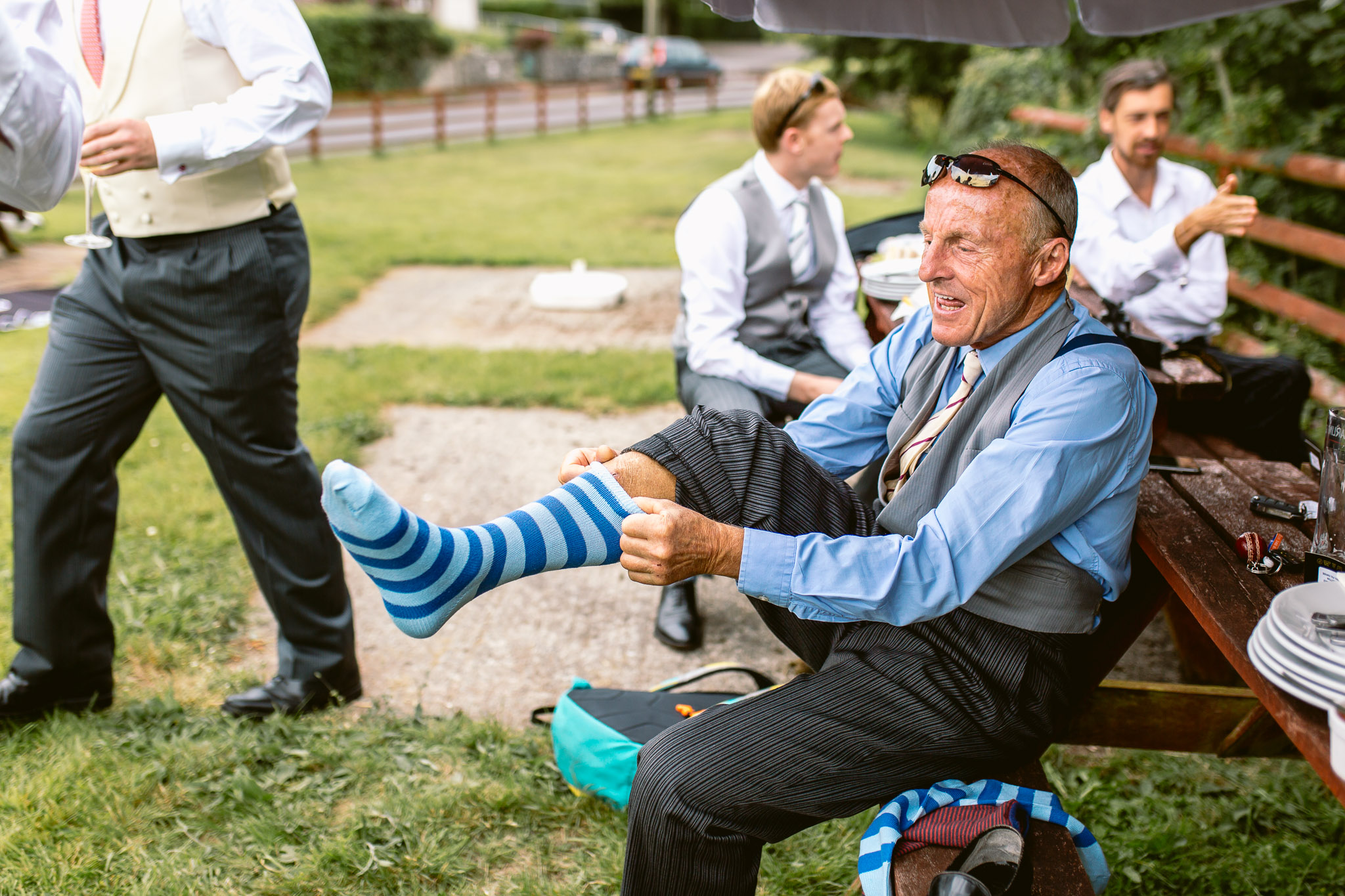 father of groom putting his socks on best of 2017