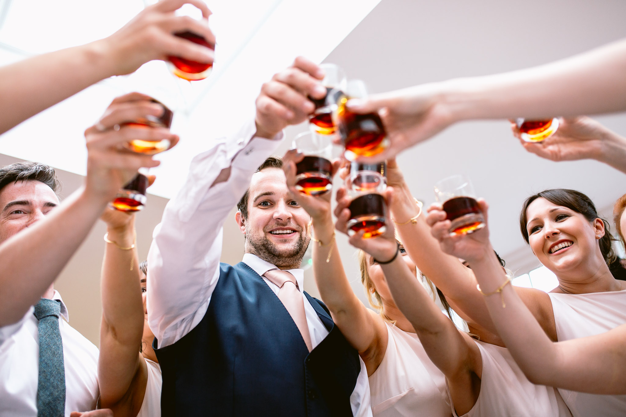 wedding guests drinking rising toast on dance floor