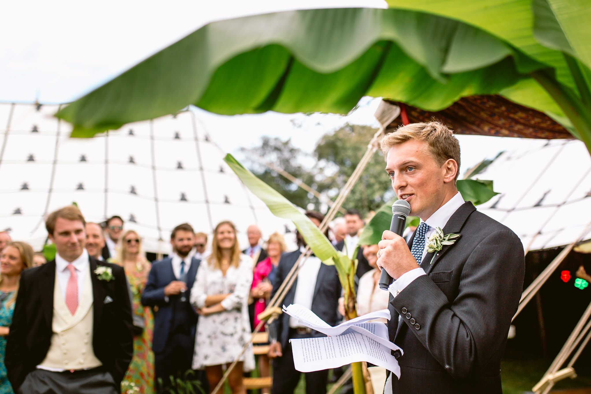 groom speaking under a big fig leaves best of 2017