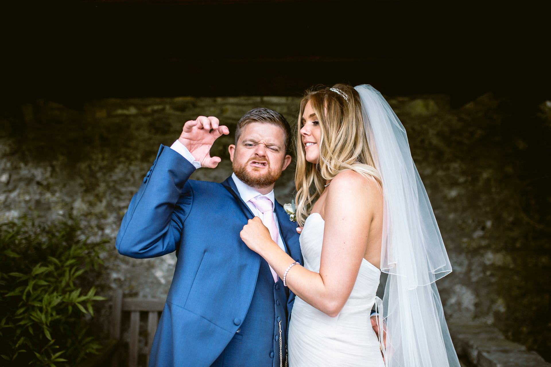 bride and groom having fun during posing in Fonmon Castle