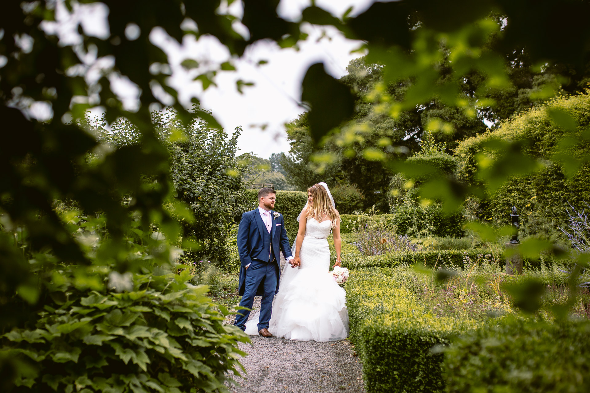 bride and groom standing in the gardens of Fonmon Castle