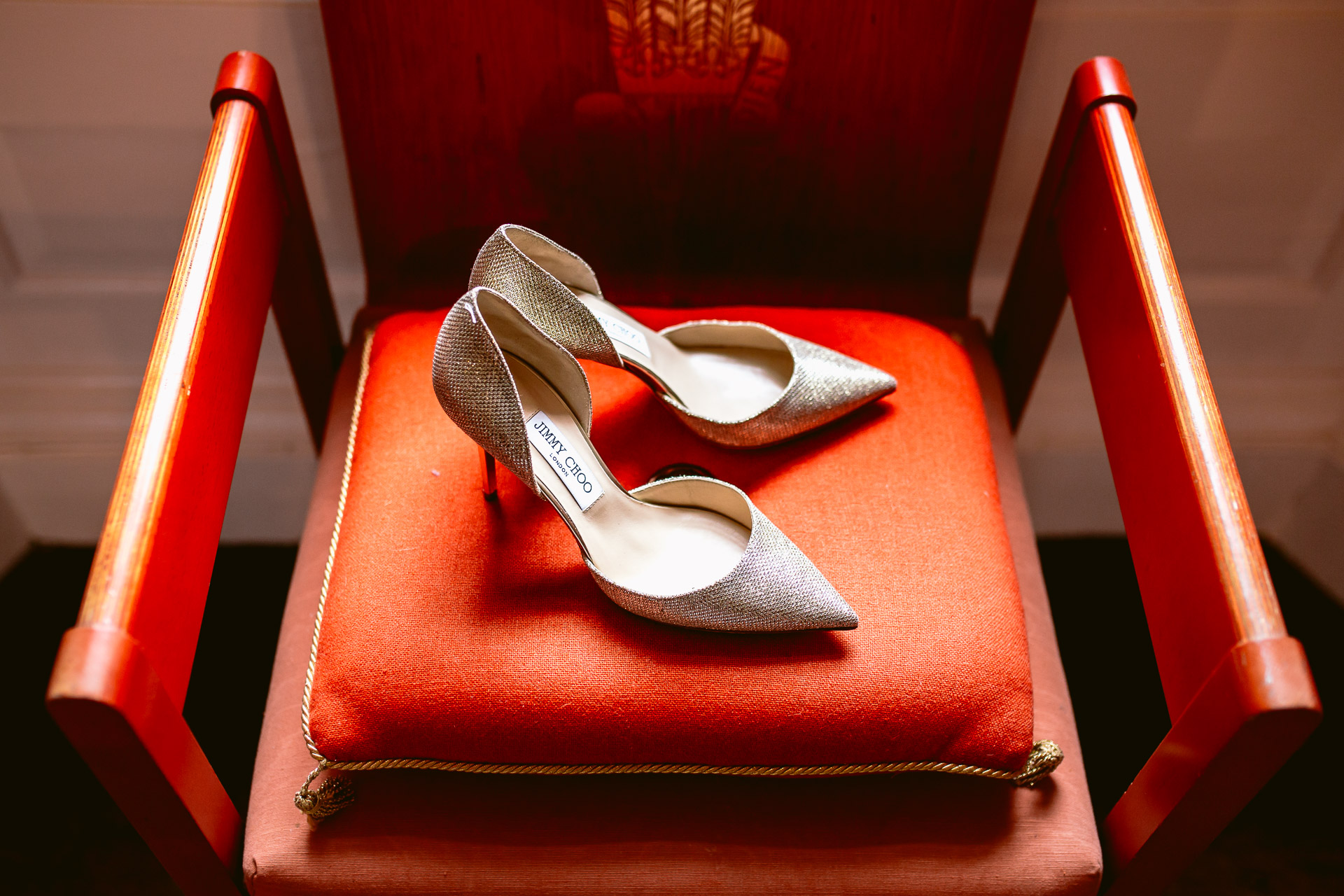 bridal shoes Jimmy Choo standing on the orange cushion in Fonmon Castle