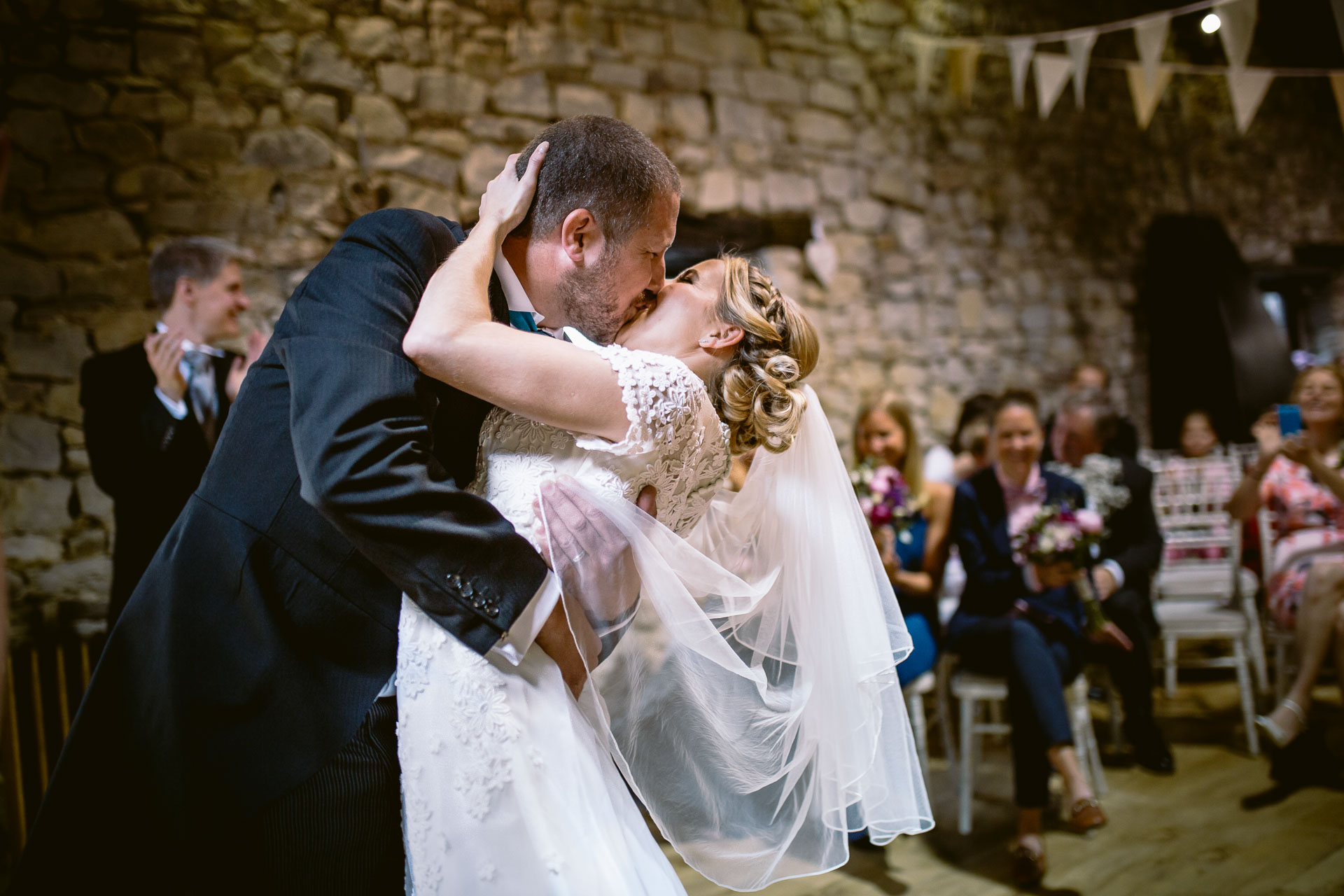 bride and groom first kiss at the wedding ceremony in Pencoed House