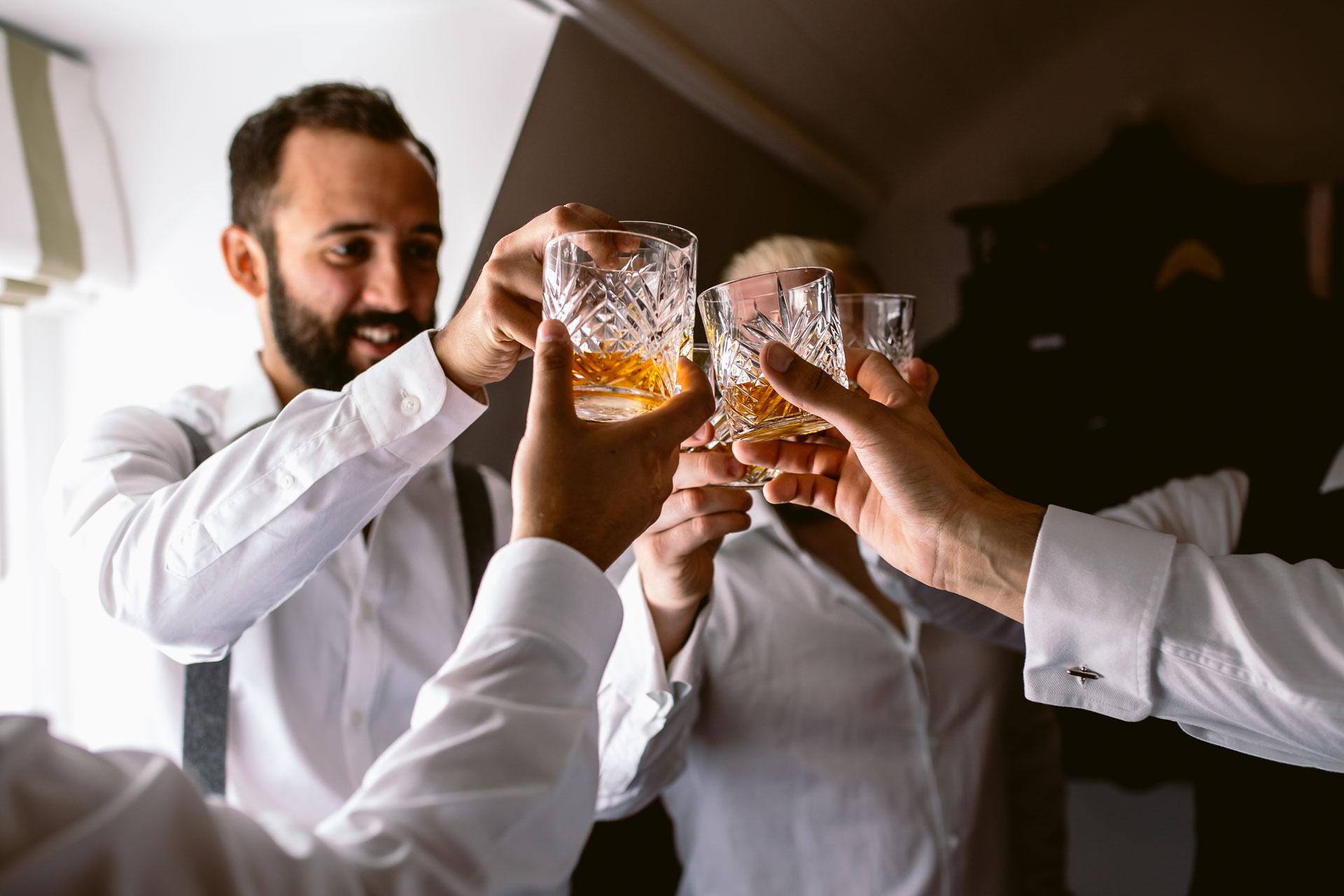 preston court boho wedding alexia and dan wedding groom preparation groomsman drinking whiskey