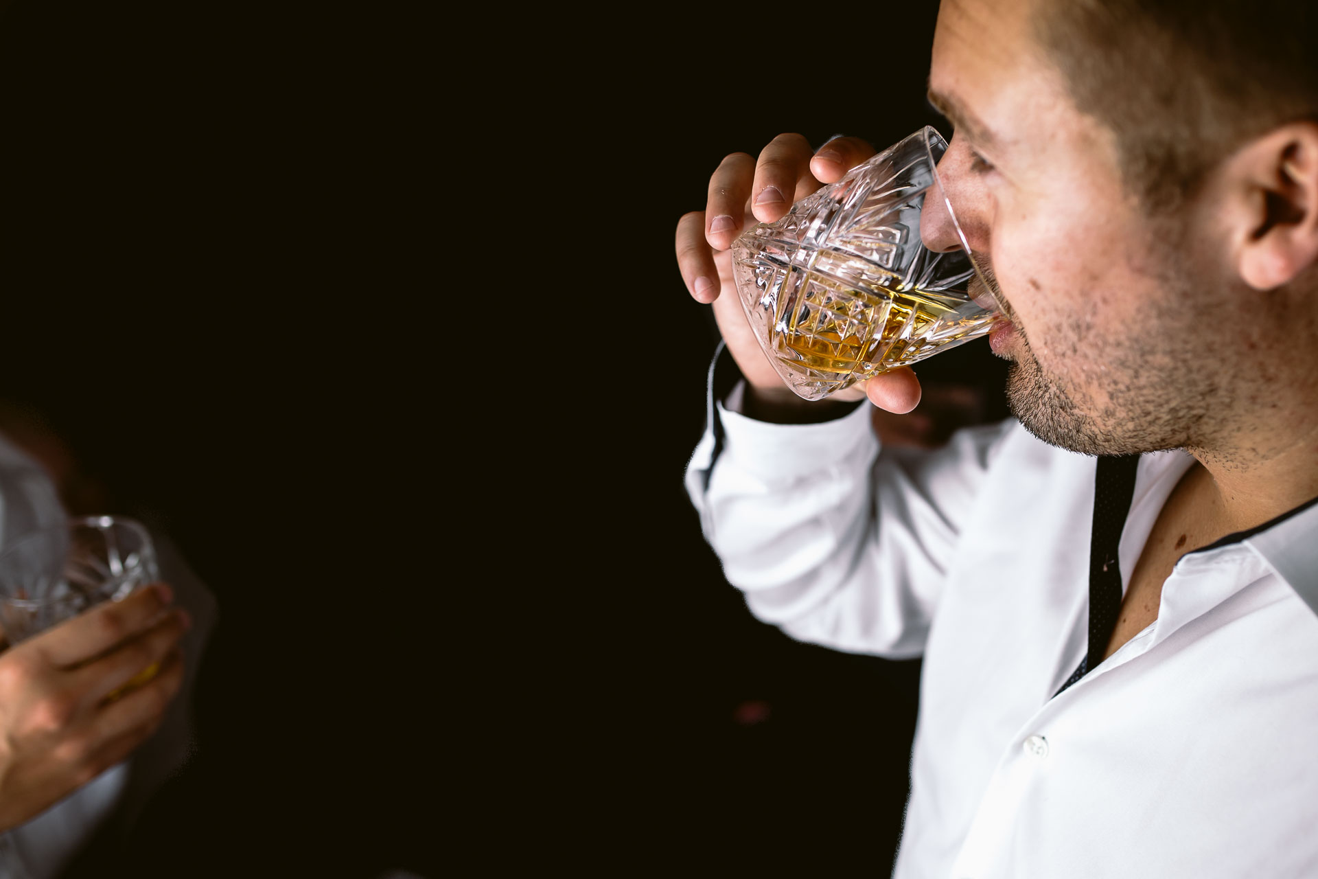 preston court boho wedding alexia and dan groom preparation groom drinking a whiskey