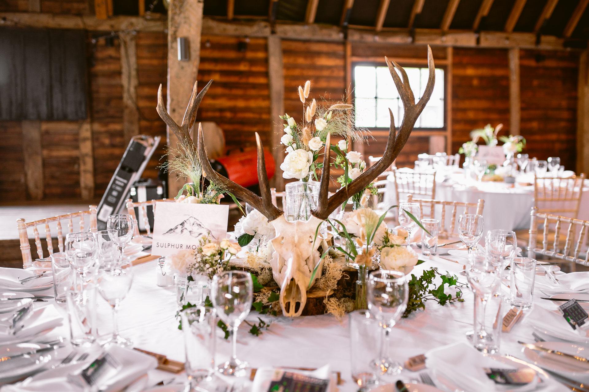 Preston court boho wedding of Alexia and dan antler table decoration