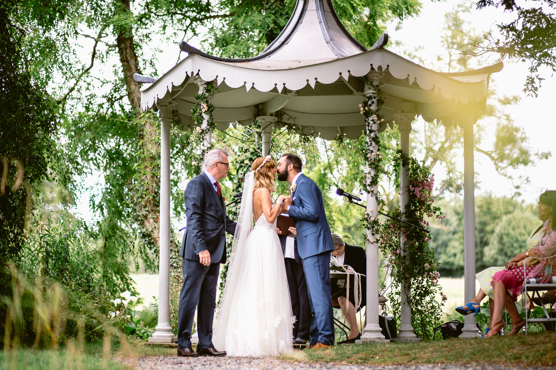 preston court boho wedding alexia and dan bride and groom exchanging the vows under canopy in the garden