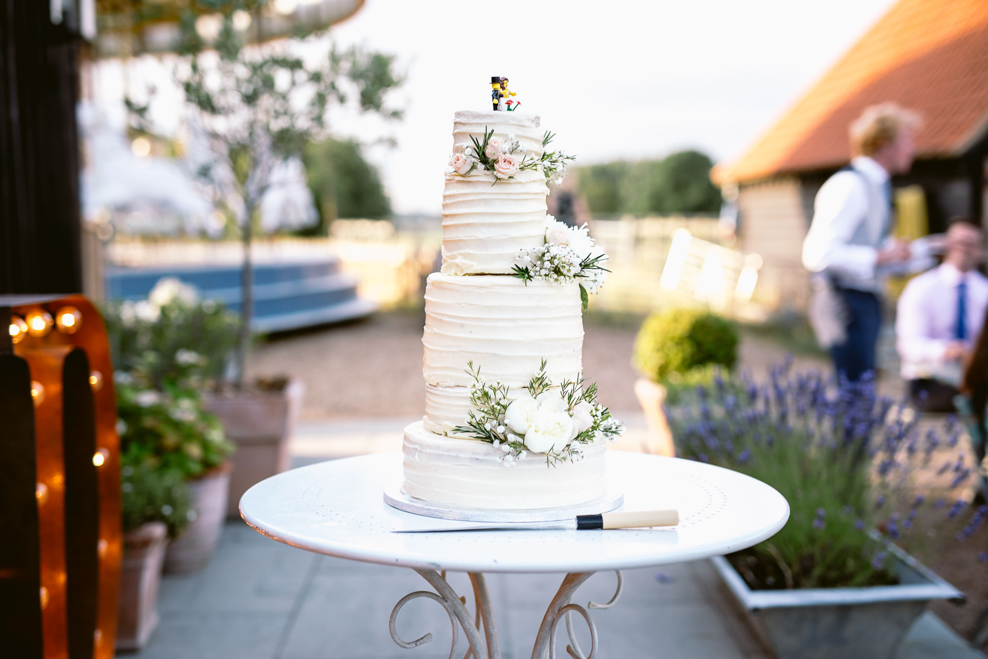 preston court boho wedding alexia and dan wedding cake look on the table outside of the venue
